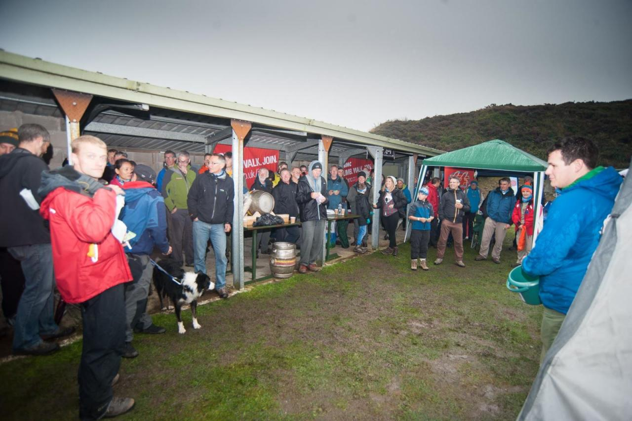 Crowds huddling into shelters, hanging out under tents, sipping warmth from free tea and enjoying the Wiltonfest raffle