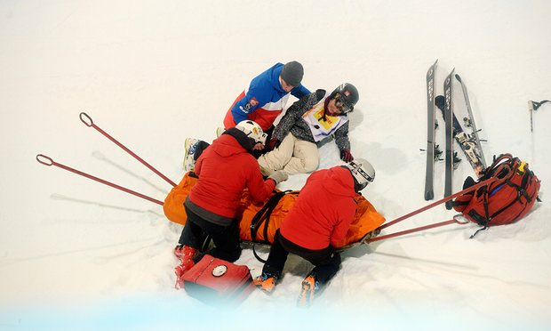 Medics help Anais Caradeux after a fall at the FIS Freestyle World Ski Championships in 2015.